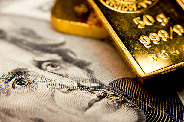 Banknote and a gold bullion stock photo