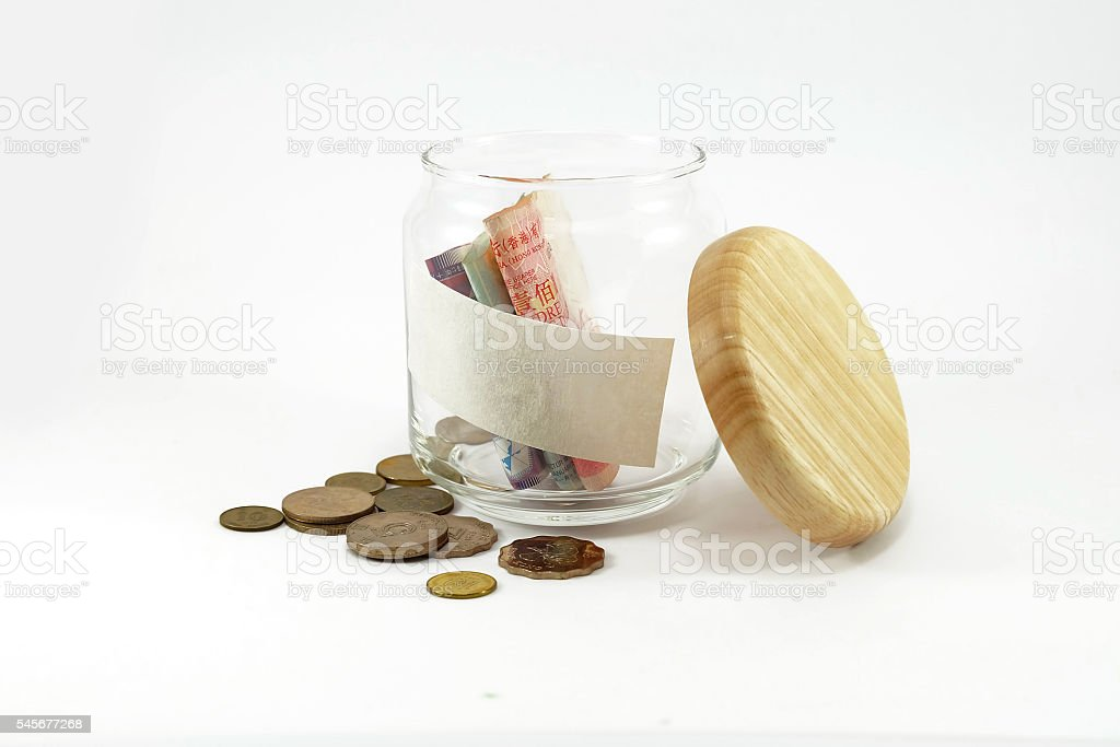 Banknote and coins in glass jar with copy space stock photo