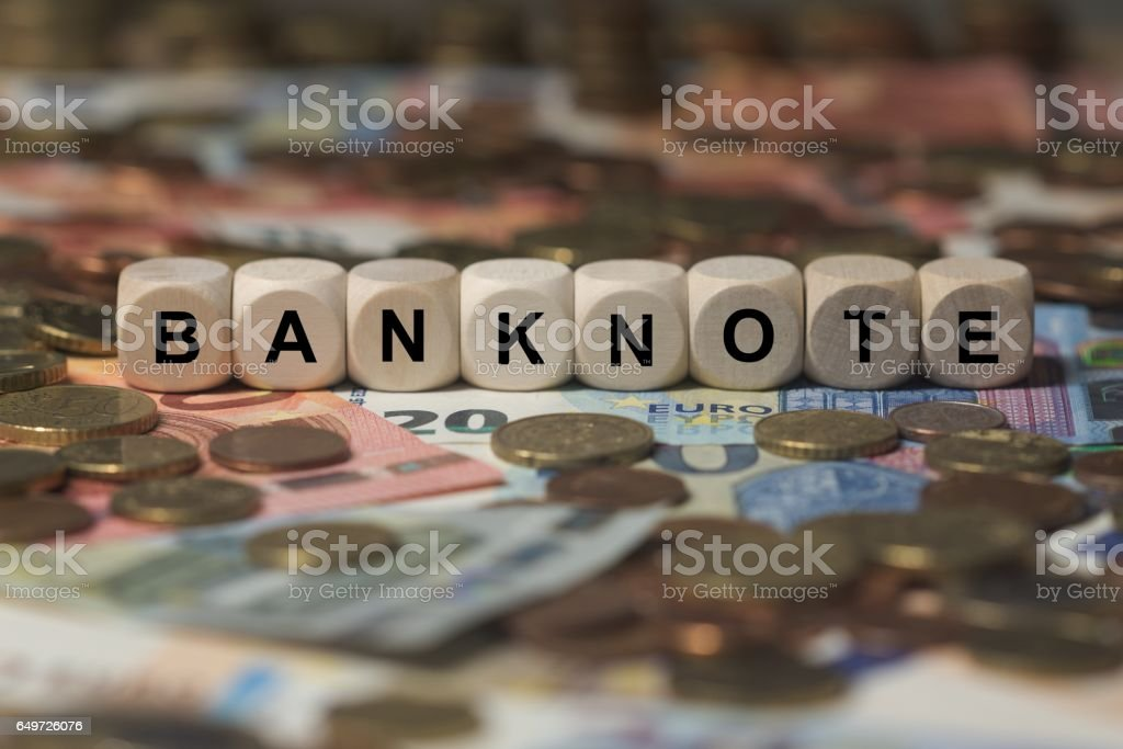 banknote - cube with letters, money sector terms - sign with wooden cubes stock photo