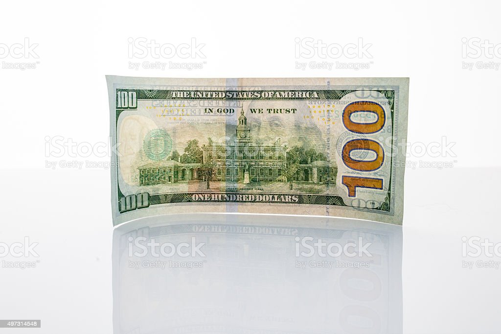 Banknote hundred dollars on the mirror surface stock photo