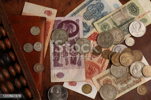 Soviet rubles from the time of the Union of Soviet Socialist Republics and old abacus