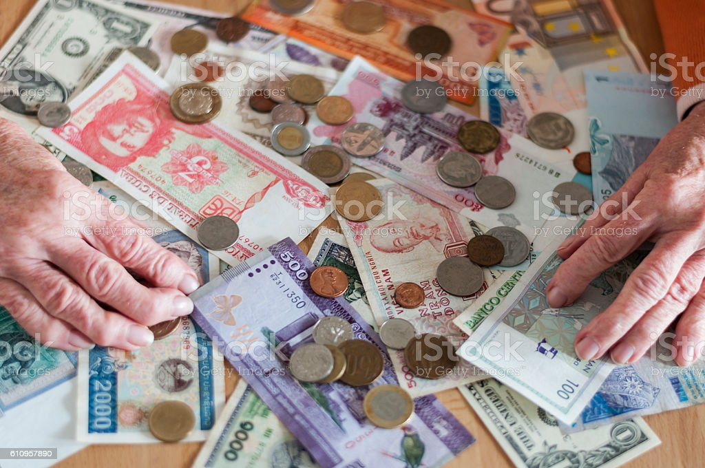 Banknotes and coins stock photo