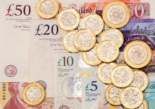 UK banknotes and Pound coins stock photo