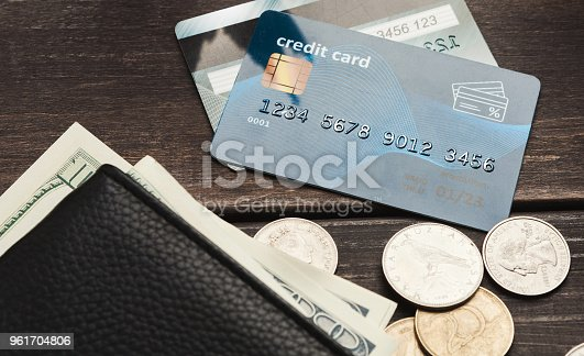 istock Banknotes in wallet with coins and credit card 961704806