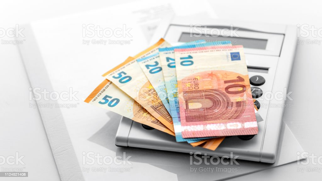 Banknotes on the calculator stock photo