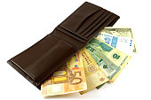 banknotes  out like a fan in a purse on a white background