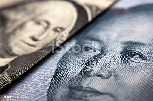 Close-up of a Chinese yuan and an American banknote