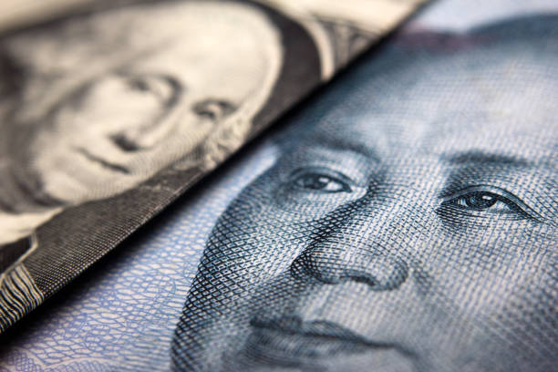 Banknotes Close-up of a Chinese yuan and an American banknote mao tse tung stock pictures, royalty-free photos & images