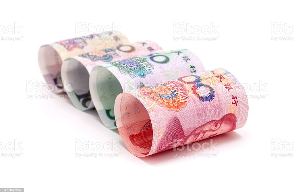 RMB banknotes rolled up on white background stock photo