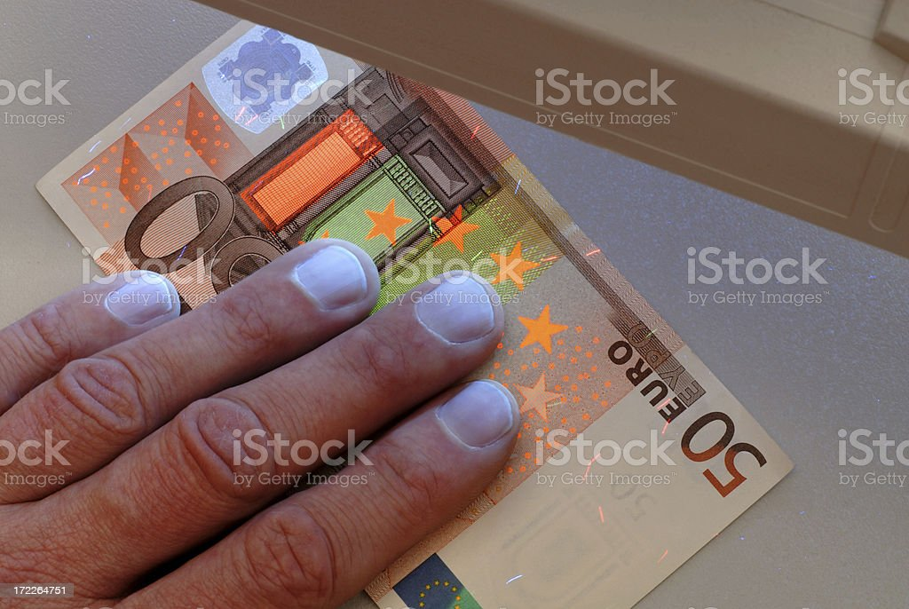 Banknotes security checking royalty-free stock photo