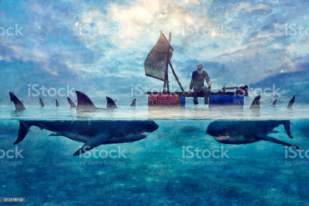 Bankrupt businessman floating on water among the sharks stock photo