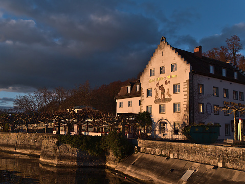 Meersburg, Germany - 12-26-2020: Bankrupt hotel Wilder Mann on the shore of Lake Constance located in a historic building constructed around 1630 in afternoon sun in winter season.