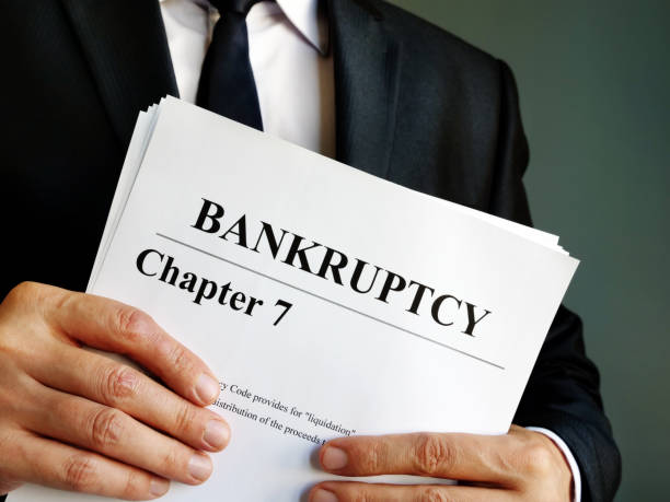 bankruptcy chapter 7 documents in the hands. - bankruptcy stock pictures, royalty-free photos & images