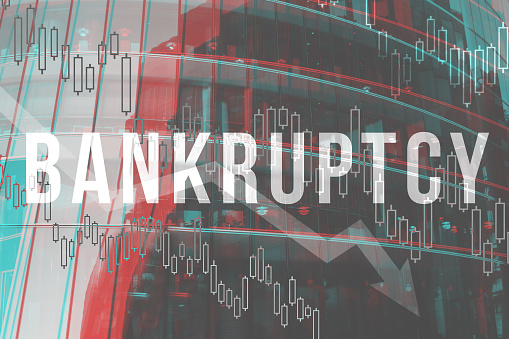 Bankruptcy concept on the background of a modern building. close up.