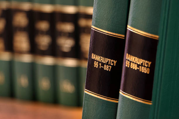 Bankruptcy law books on shelf bookshelf for legal reference Bankruptcy law books on shelf bookshelf for legal reference bankruptcy stock pictures, royalty-free photos & images