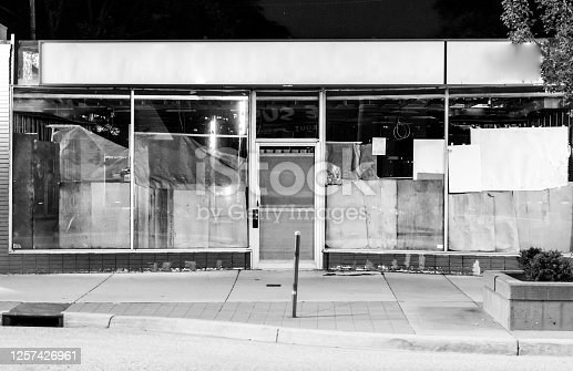 A store front is boarded up after the business has declared bankruptcy.