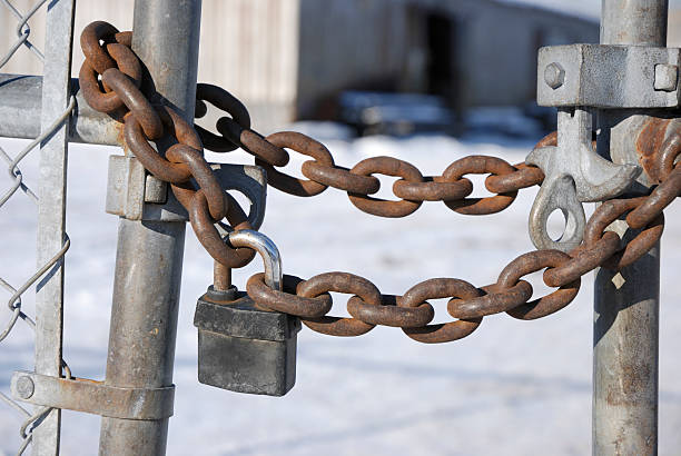 "Bankruptcy out of business ""Close up on chain and lock on a fence of an abandon industrial building.Concept for recession,depression,unemployed,...."" lockout stock pictures, royalty-free photos & images"