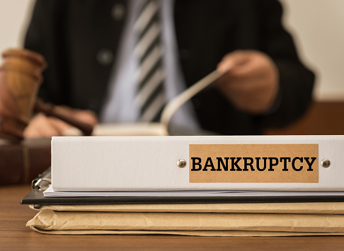 Bankruptcy document folder with lawyer work at law firm. concept of bankruptcy law, bankrupt,bankruptcy court,