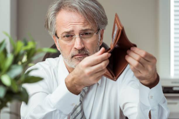 Bankruptcy Sad businessman showing empty wallet. Bankruptcy concept. empty wallet stock pictures, royalty-free photos & images
