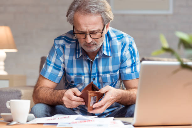 Bankruptcy Worried man looking at empty wallet. Bankruptcy concept. empty wallet stock pictures, royalty-free photos & images