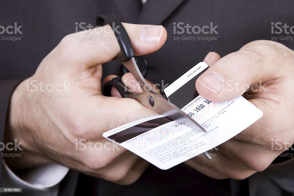 Banqueroute-ciseaux une carte de crédit photo libre de droits