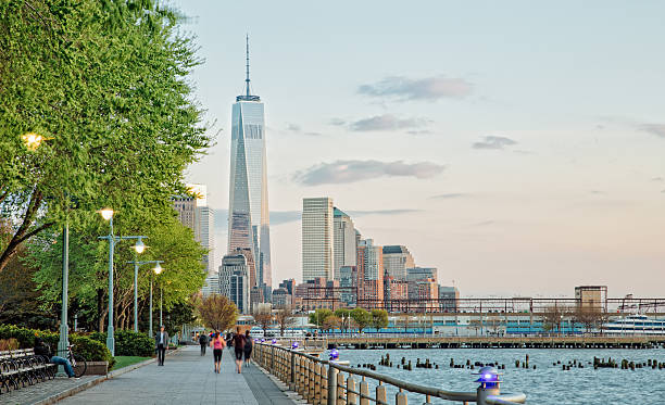 Banks of Hudson River and Freedom Tower Banks of Hudson River and Freedom Tower hudson river stock pictures, royalty-free photos & images