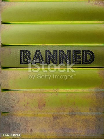 istock Banned content document, green stack of generic books 1147068241