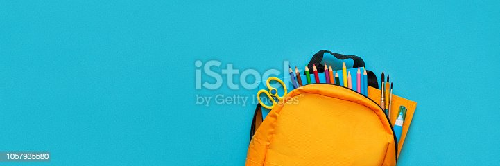 Banner 3:1 for Web. Back to school concept. Backpack with school supplies. Top view. Copy space