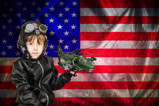 happy independence day, banner, american patriotic background. american boy in the helmet of the pilot, in the hands of a toy helicopter, copy space. - family 4th of july zdjęcia i obrazy z banku zdjęć