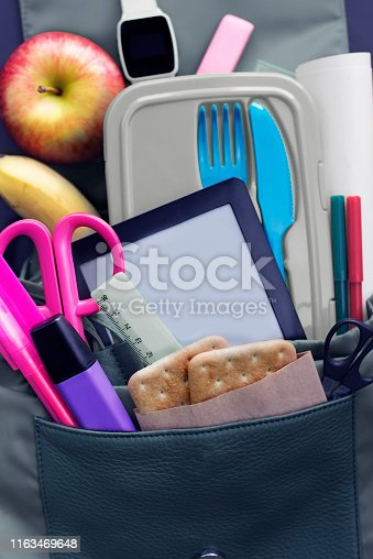istock Banner Background back to school. Stationery pencil pen ruler backpack lunch box on black background 1163469648