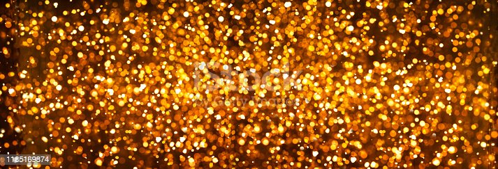 846933050 istock photo Banner Christmas golden bokeh. Bright holiday lights 1185169874