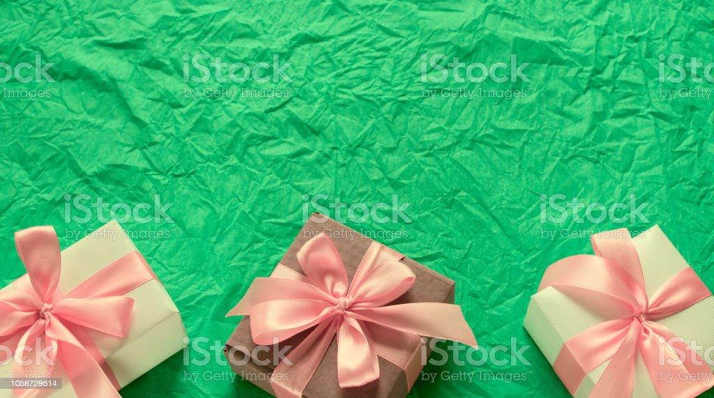 Banner Decorative festive background with gift boxes. Textured green...