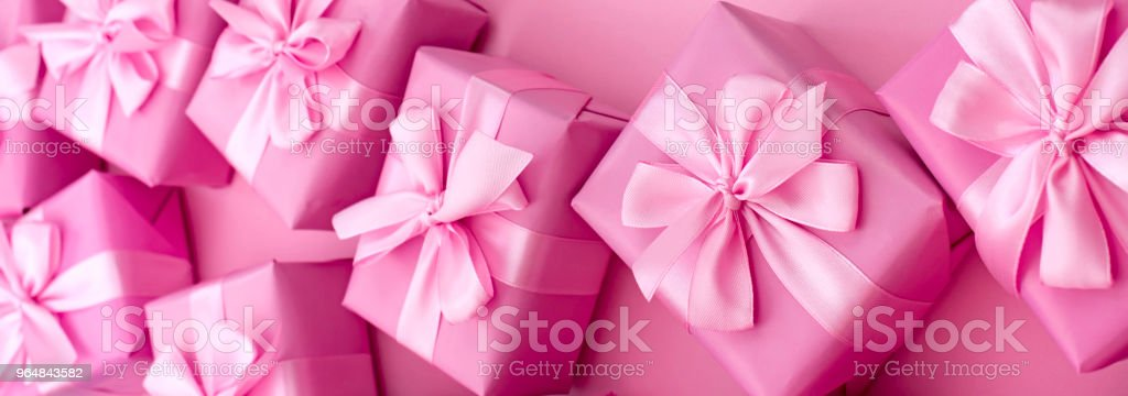 Banner Decorative holiday gift boxes with pink color on pink background. royalty-free stock photo