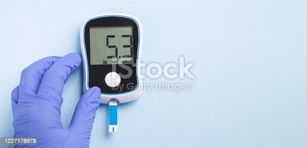 istock Banner doctor`s hand holding glucose meter 1227178978
