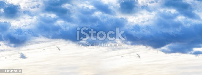 istock Banner. Evening sky with dark clouds before the rain, sunset. Vertical photography 1142345510
