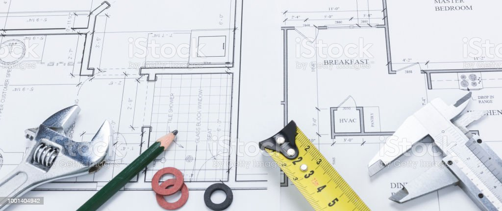 Banner Image of Spanner, Pencil, and Measuring Tools on Building Plan stock photo