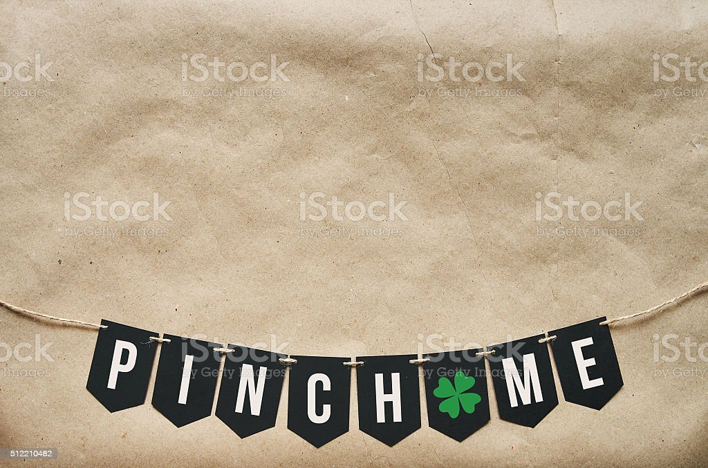 PINCH ME banner lettering on eco craft paper background stock photo