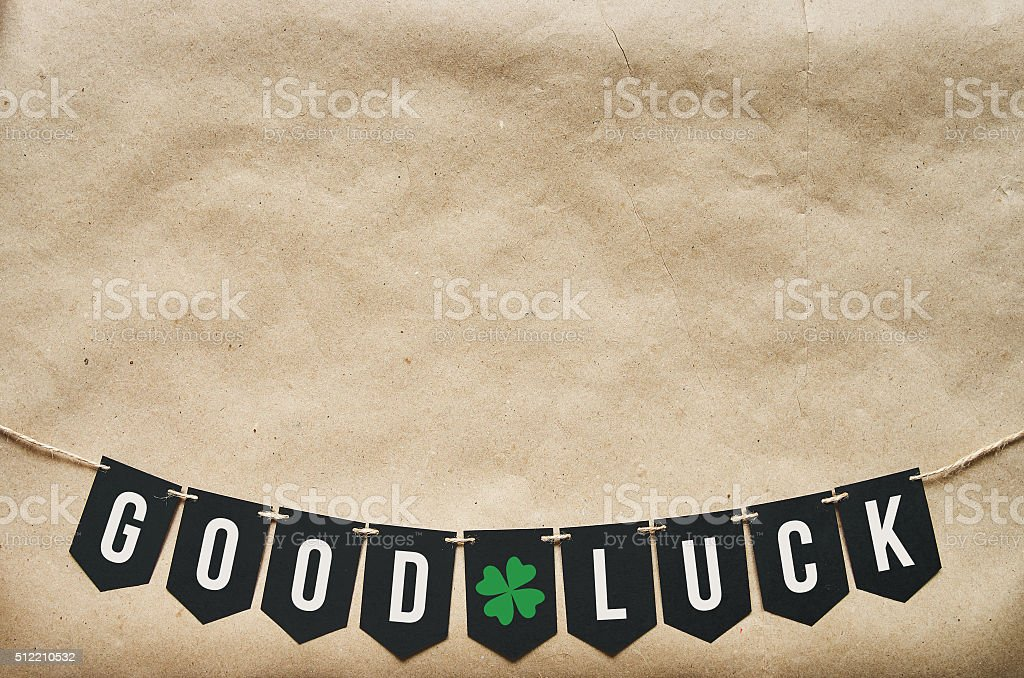 GOOD LUCK banner lettering on eco craft paper background stock photo