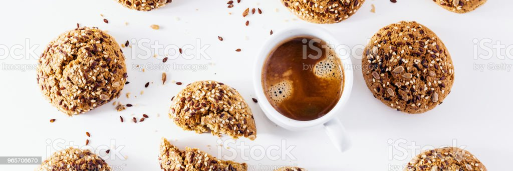 banner of a cup of espresso and fresh biscuits on a white backgr stock photo