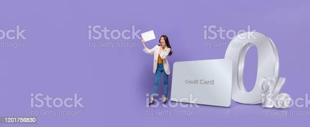 Banner of asian woman standing next to credit card with 0 interest picture id1201756830?b=1&k=6&m=1201756830&s=612x612&h=e  sanfv31ac9badsybkcoqem8byh7niapph vqcnoe=
