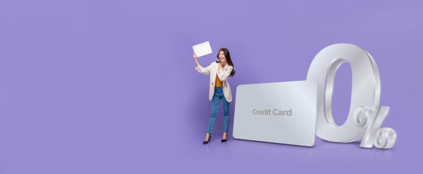 Banner of Asian woman  standing next to credit card with 0% interest installment payment plan stock photo