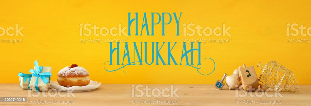 Banner of jewish holiday Hanukkah with wooden dreidels