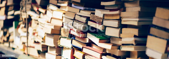 istock Banner of Stack of books at the bookshop 845555662
