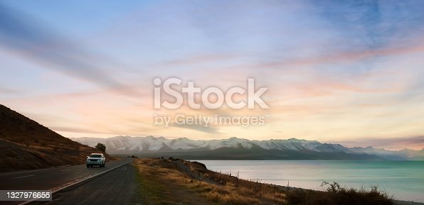 istock Banner of traveling on the road with mountain range near lake  in New zealand 1327976655