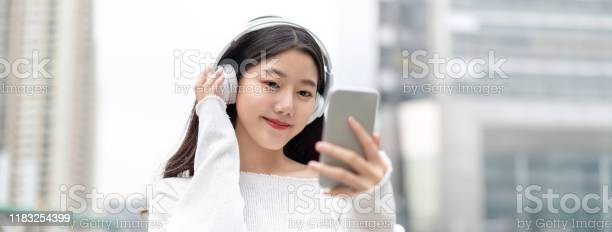 Banner of young happy pretty cute asian woman looking at smartphone picture id1183254399?b=1&k=6&m=1183254399&s=612x612&h=8g 6gwpe3bzacpx4sj 1isgb9itos1gzgxrupgfzjhy=
