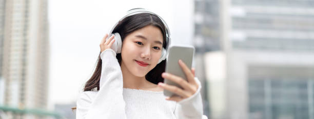 Banner of young happy pretty cute asian woman looking at smartphone picture id1183254399?b=1&k=6&m=1183254399&s=612x612&w=0&h=0nu6gkhfbeymayzl0zu30cdaim1t506tvgmikxvee6m=