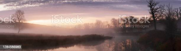 Photo of Banner panoramic autumn landscape fog over river and sky with rising sun