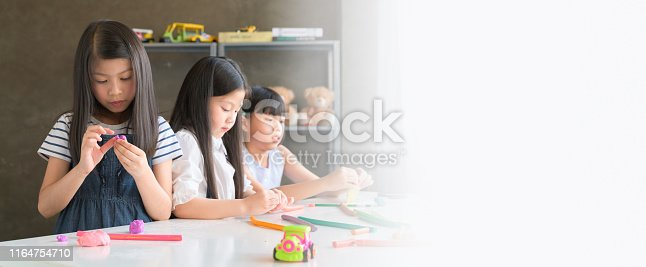 818533812 istock photo Banner Ratio Web Design of Asian Kid in Creative Art workshop at school. 1164754710