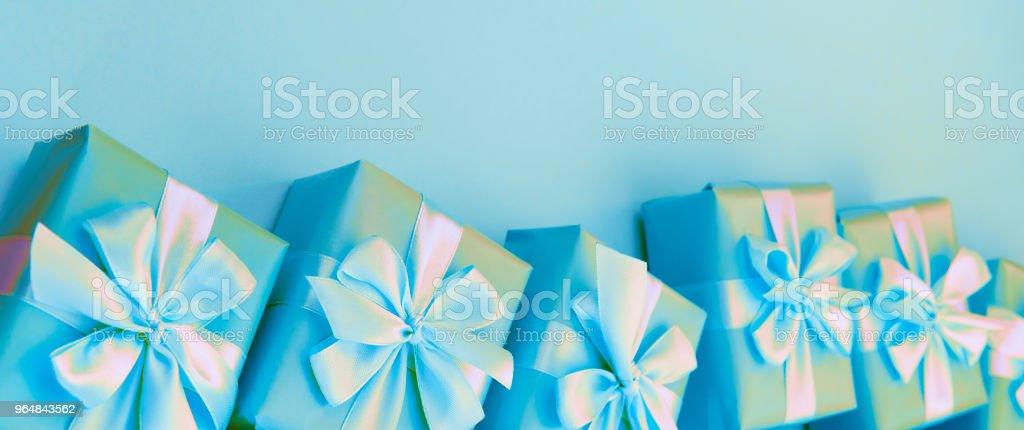 Banner surrealism Decorative holiday gift boxes with pink color on pink background. royalty-free stock photo