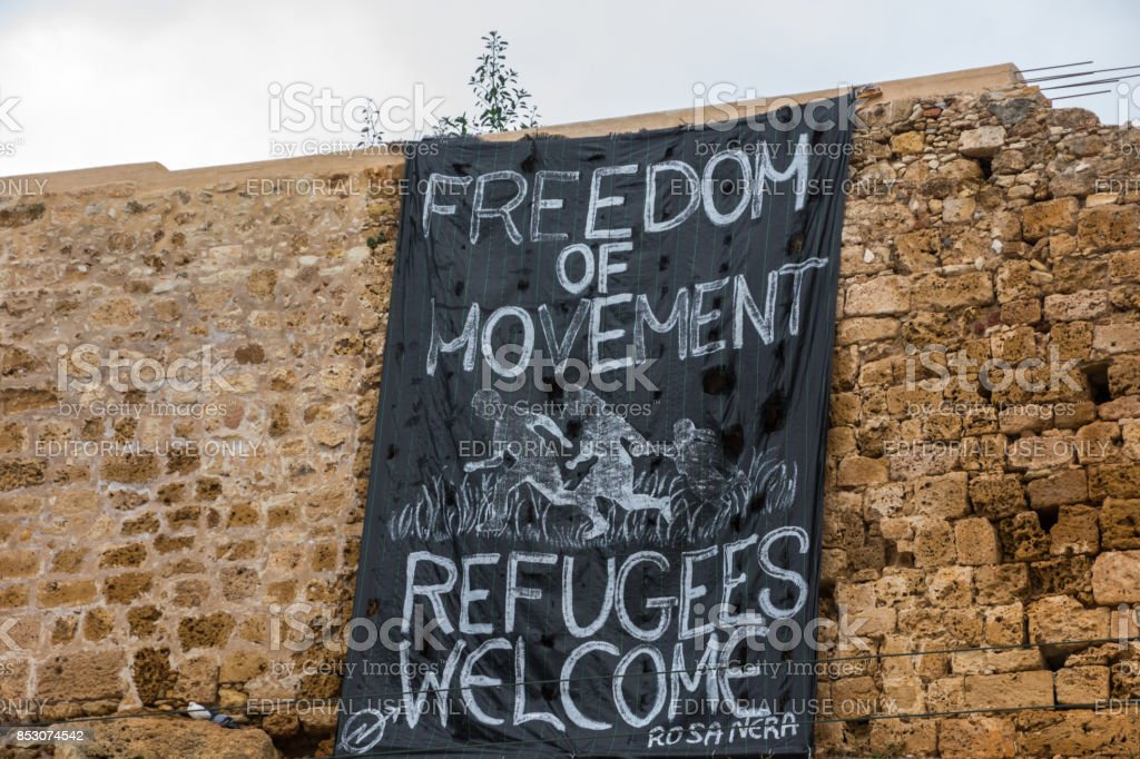 Banner Welcoming Refugees in Crete, Greece October 2, 2015 Chania, Island of Crete, Greece   Adult Stock Photo